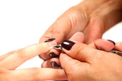 Cutting the cuticle with cutter Stock Photos