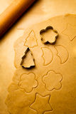 Cutting of different shapes of gingerbread cookies stock photography