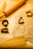 Cutting of different shapes of gingerbread cookies Stock Photos