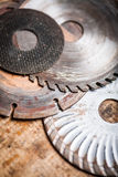 Cutting disks on wooden plank Royalty Free Stock Photo