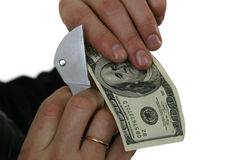 Cutting dollars Stock Images