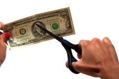 Cutting dollars Stock Photo