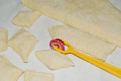 Cutting dough for cookies. Cutting dough curved knife cookie cutter Royalty Free Stock Photography