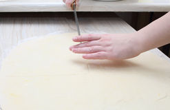 Cutting dough Stock Photo
