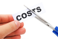 Cutting down a tag of costs. On white Stock Photo