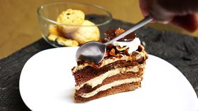 Cutting and eating layered chocolate cake