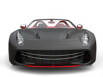 Cutting edge sports car - matte black with fiery red details. Front view closeup Royalty Free Stock Image