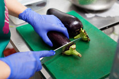 Are cutting eggplants on the board Stock Image