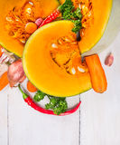 Chunks of pumpkin with herbs and spices , soup preparation, Stock Photo