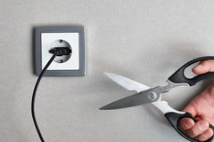 Cutting electricity concept stock images