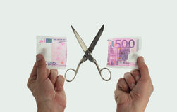 Cutting 500 euro note Stock Photo