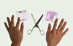 Cutting 500 euro note Stock Photos