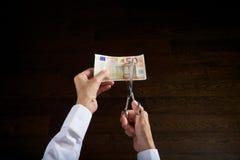Cutting euros Stock Photos