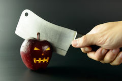 Cutting evil apple Stock Photography