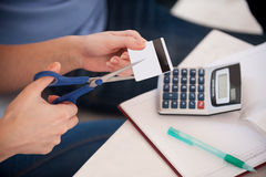 Cutting the expenses. Stock Photos