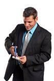 cutting för affärsmankortkreditering royaltyfria bilder