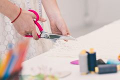 Cutting fabric Royalty Free Stock Images