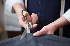Cutting fabric Stock Photography
