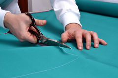 Cutting a fabric. Stock Photography