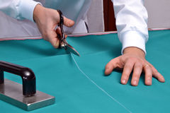 Cutting a fabric. Royalty Free Stock Image