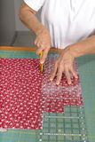 Cutting fabric for use in a quilt. Stock Image