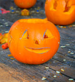 Cutting face of pumpkin Stock Images