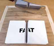 Cutting Fat. With a cleaver and cutting board Stock Photos