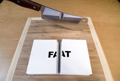 Cutting Fat. With a cleaver and cutting board Stock Photo