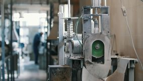 Cutting fiberglass rods - manufacture of composite reinforcement, industry for construction, close up. View stock video