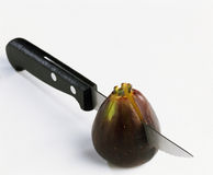 Cutting a fig in two Stock Photo