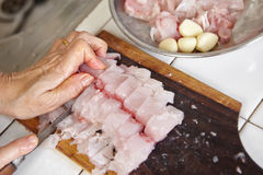 Cutting fish. Cutting the fish to make fish ball Royalty Free Stock Images