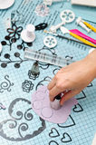 Cutting fondant circles. Hand cutting fondant pieces for decorations Stock Photos