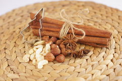 Cutting forms with nuts, star anise and cinnamon Royalty Free Stock Photography