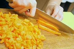 Cutting fresh carrot on the cutting board Stock Photo