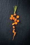 Cutting fresh carrot Royalty Free Stock Image