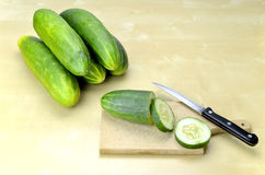 Cutting fresh cucumber in slices Stock Photos