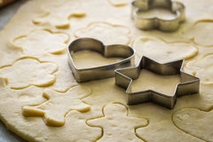 Cutting from fresh dough sweet milky biscuits Stock Photography