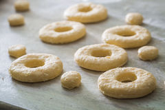 Cutting from fresh dough traditionally and delicious donuts. Closeup of cutting from fresh dough traditionally and delicious donuts Stock Photo