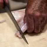 Cutting fresh fish Royalty Free Stock Photos