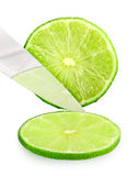 Cutting fresh green lime Royalty Free Stock Images