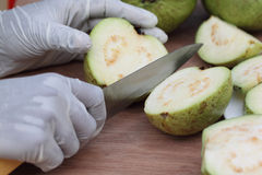 Cutting fresh guava Royalty Free Stock Images