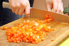 Cutting fresh paprika on the cutting board Royalty Free Stock Photography