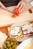 Cutting fresh tomato Royalty Free Stock Images