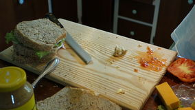 Cutting freshly prepared sandwiches at Mac's pizzeria stock video footage
