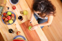 Cutting fruits Royalty Free Stock Images