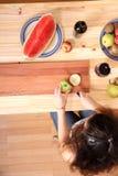Cutting fruits Stock Image