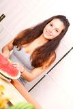 Cutting fruits Stock Images