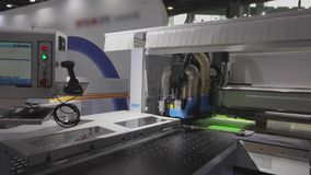 Cutting furniture blanks CNC machine. CNC machine on the stand in China. Cnc machine at the exhibition of hardware technology. CNC machine tool at work at the stock footage