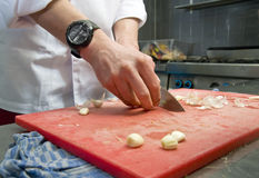 Cutting Garlic Stock Image