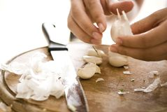 Cutting garlic stock photography